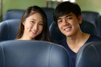 Happy young Asian tourist couple travelling together at the railway station