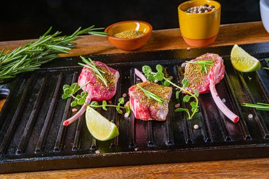 Seasoned and Herb Marinated Raw Lamb Chops