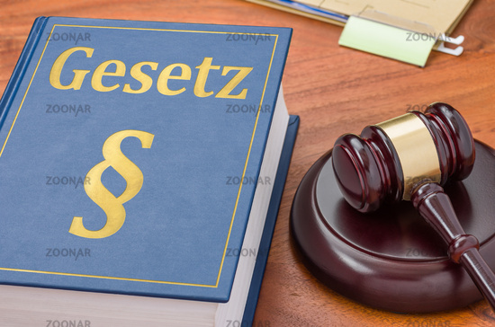 A law book with a gavel -  German Translation of Law - Gesetz