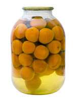 glass jar with a compote of canned apricots isolat