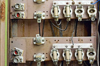 old switchboard with fuses in the background