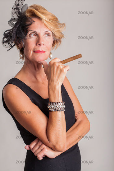Elegant woman with a cigar