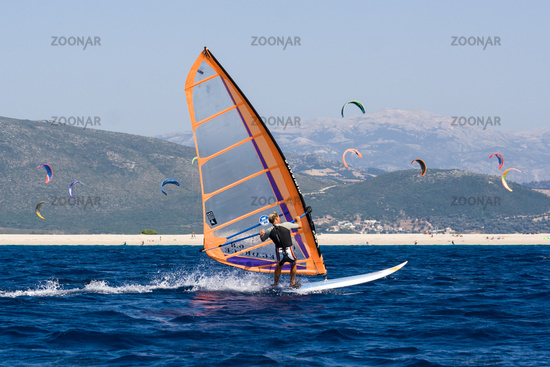 Windsurfing along the coast in the middle of the k