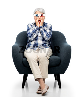 scared senior woman in 3d glasses watching movie