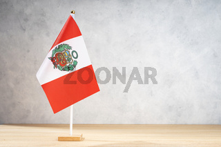 Peru table flag on white textured wall. Copy space for text, designs or drawings