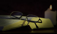 glasses, book and a candle