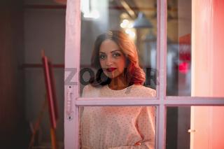 Calm woman in room near door