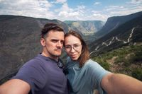 Couple selfie on the top of Altai mountain
