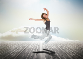Woman jumping over wooden boards