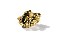 Gold nugget on a white background