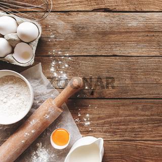 Baking concept flat lay. Ingredients, kitchen utensils, wooden background