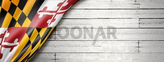 Maryland flag on white wood wall banner, USA