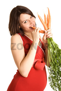 pregnant woman with fresh carrots