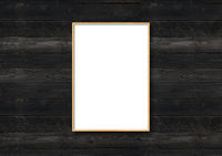 Black picture frame hanging on a black wooden wall