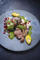 Modern style traditional barbecue T-Bone lamb steaks with Greek feta cheese