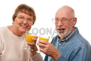 Happy Senior Couple with Glasses of Orange Juice