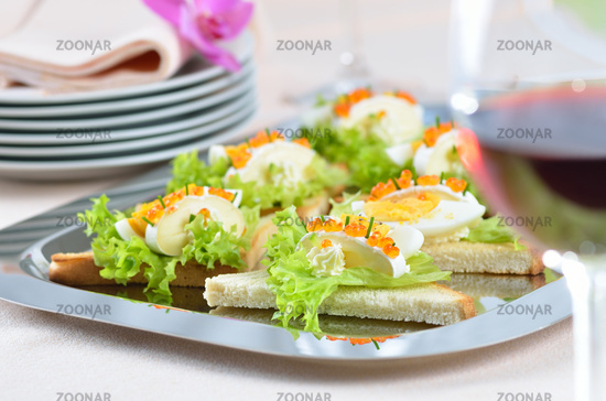 Appetizers with cheese and caviar