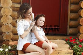 Happy mother and daughter embracing near door