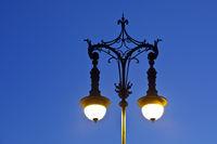 Glowing old Berlin gas lantern in the evening, Pariser Platz, Berlin, Germany, Europe