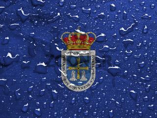 flag of Oviedo, Spain with rain drops