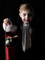Boy in Halloween vampire costume