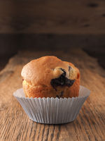 Blueberry muffin on a wooden kitchen table
