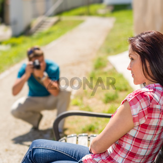 Young man take photo of his girlfriend