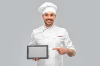 happy smiling male chef showing tablet pc computer