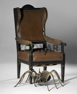 winged chair and metallic spider