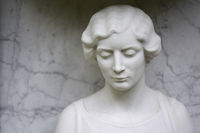 female cemetery sculpture made of white marble