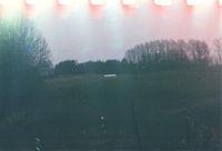 Dull meadow, analogue 35mm format, light leak
