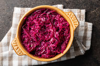 Red sauerkraut. Sour pickled cabbage in bowl.