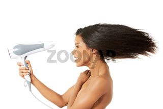 Woman with long hair holding blow dryer