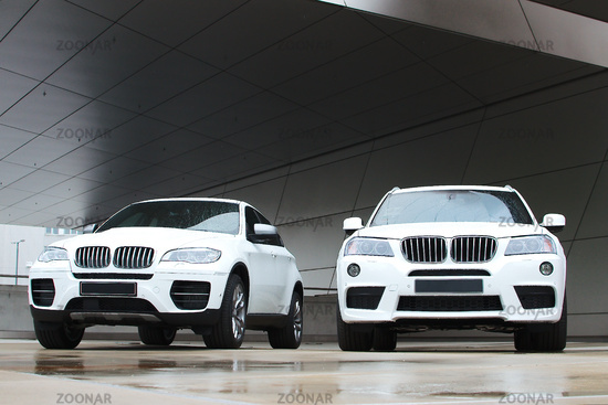 Two white BMW cars