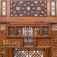 Arabesque ornaments of an old aged decorated wooden wall