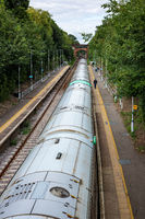 EAST GRINSTEAD, WEST SUSSEX, UK - AUGUST 27 : Train at East Grinstead Railway Station in East Grinstead West Sussex on August 27, 2021. Three unidentified people