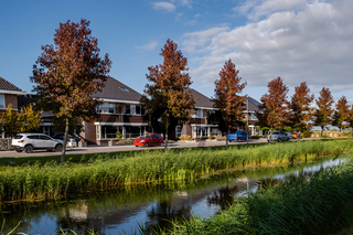 Dutch Suburban area with modern family houses, newly build modern family homes in the Netherlands, dutch family house, apartment house. Netherlands