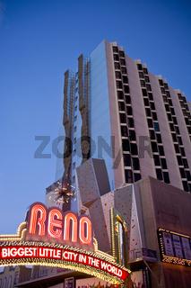 Reno Sign Beside Giant Rock Climbing Wall