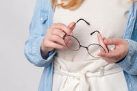Ginger woman Holds glasses in hands