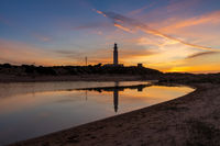 the Cape Trafalgar lighthouse after sunset with colorful evening sky