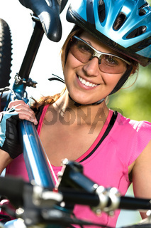 Female cyclist carrying her bike