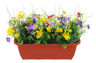 Composition of artificial garden flowers in brown flowerpot isolated on white background.