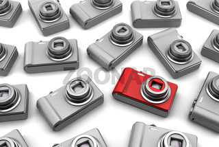 red point and shoot photo camera among gray similar isolated on white background