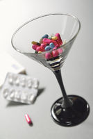 cocktailglass with pills