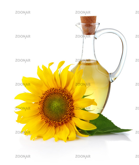 Jug sunflower oil with flower isolated on white