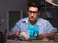 Student preparing for exams late night at home