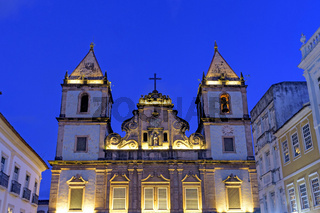 Illuminated facade of an ancient and historic church located in Salvador, Bahia