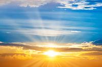 Sunset sky with sun rays