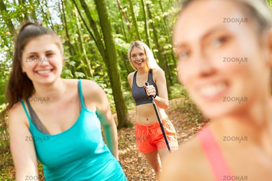 Girlfriends Nordic Walking in Nature