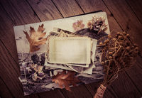 Memories - stock of old and vintage photos on wooden background with copy space